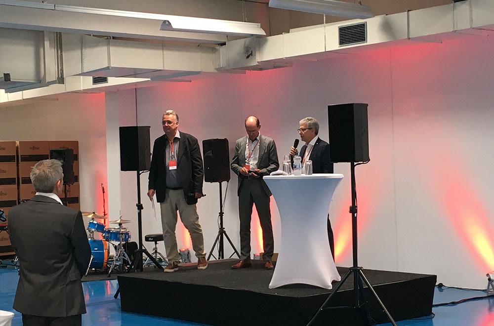 Martin Voelker, Roland Bihler und Max H.-H. Schaber bei der Eröffnung in Leinfelden